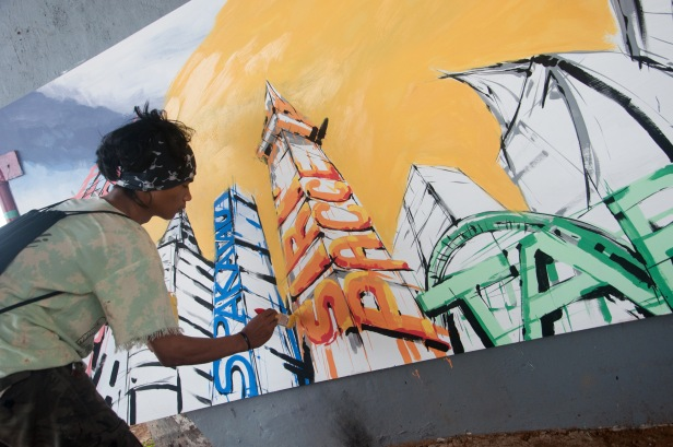 Participant paints on a whiteboard in Makassar, Indonesia on October 10, 2015. Some Indonesian college students gathered under the Makassar Fly Over to participate the Urban Paint Competition held by Architecture Department Student Association of Hasanuddin University.