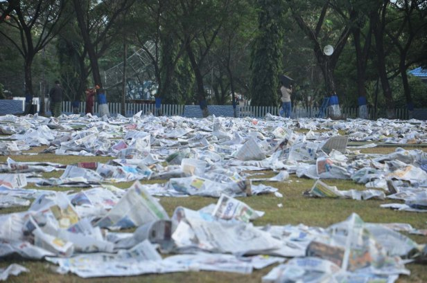 Prayer attendand left sheets of newspaper they used during Eid Al-Fitr prayer in Makassar, Indonesia on July 17, 2015.