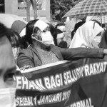 Pekerja perempuan alam demo buruh.