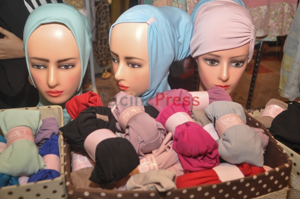 Female mannequin heads wear headscarfs or hijabs at Indonesia Moslem Fashion Expo. Muslim fashion Industry grows very fast in Indonesia in the past several years. As common fashion, Muslim clothing is changing consistently. Every year, there are many new designers and brands come.