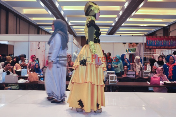 Indonesian muslim women walk on the catwalk during a fashion competition at Indonesia Moslem Fashion Expo. Muslim fashion Industry grows very fast in Indonesia in the past several years. As common fashion, Muslim clothing is changing consistently. Every year, there are many new designers and brands come.