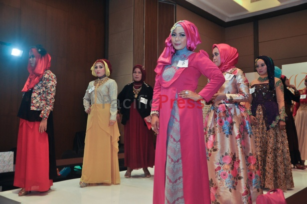 Participants of a fashion competitions stand on the catwalk during Indonesia Moslem Fashion Expo. Muslim fashion Industry grows very fast in Indonesia in the past several years. As common fashion, Muslim clothing is changing consistently. Every year, there are many new designers and brands come.