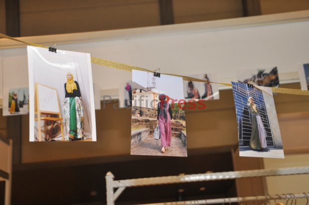 Pictures of models wear muslim clothes hang at a booth during Indonesia Moslem Fashion Expo. Muslim fashion Industry grows very fast in Indonesia in the past several years. As common fashion, Muslim clothing is changing consistently. Every year, there are many new designers and brands come.