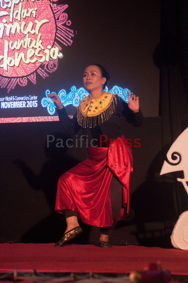 A woman performs a traditional dance at Eastern Indonesia Forum Festival. The festival was attended by many civil societies and NGOs from many areas in Eastern Indonesia and became an event to display and study achievement of many smart practices done by local communities based on their local wisdom in order to improve their welfare.