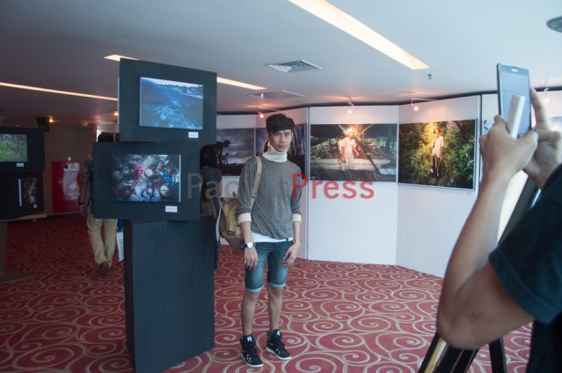 A man poses in exhibition room at Eastern Indonesia Forum Festival. Dozens photos of Eastern Indonesia life made by Makassar based photographer Yusuf Ahmad exhibited during the festival.