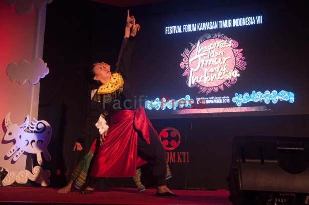 A woman and a man perform traditional dance at Eastern Indonesia Forum Festival. The festival was attended by many civil societies and NGOs from many areas in Eastern Indonesia and became an event to display and study achievement of many smart practices done by local communities based on their local wisdom in order to improve their welfare.
