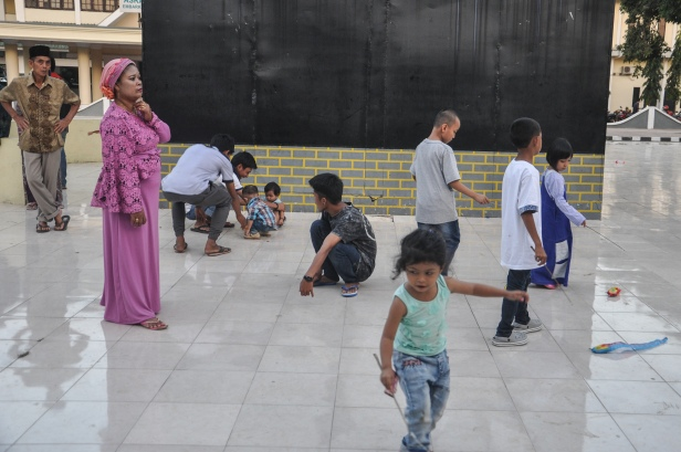 Makassar, Indonesa. Kids play at a public space.